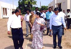 Mr M. H. Upadhyaya, Mrs Rajashree Birla and Mr K. K. Maheshwari take a tour of the homes