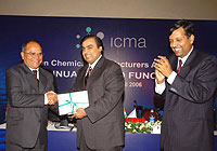 Mr. P. N. Ojha receives the award from Mr. Mukesh Ambani
