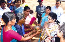 Mrs. Rajashree Birla is welcomed warmly by the grateful villagers
